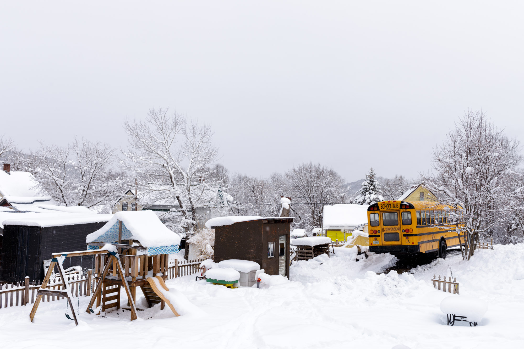 School Bus in Backyard With Snow