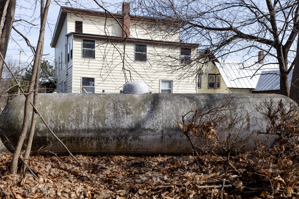 Oil Tank Behind House