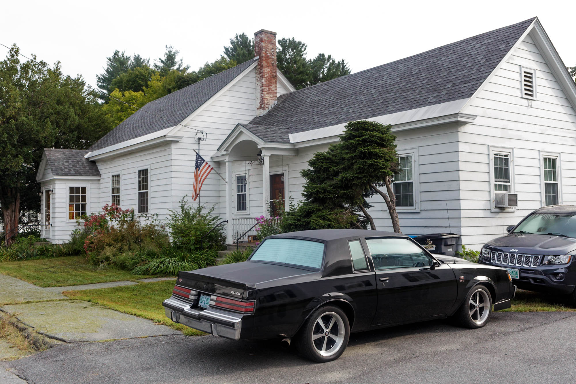 Black Car in Front of House