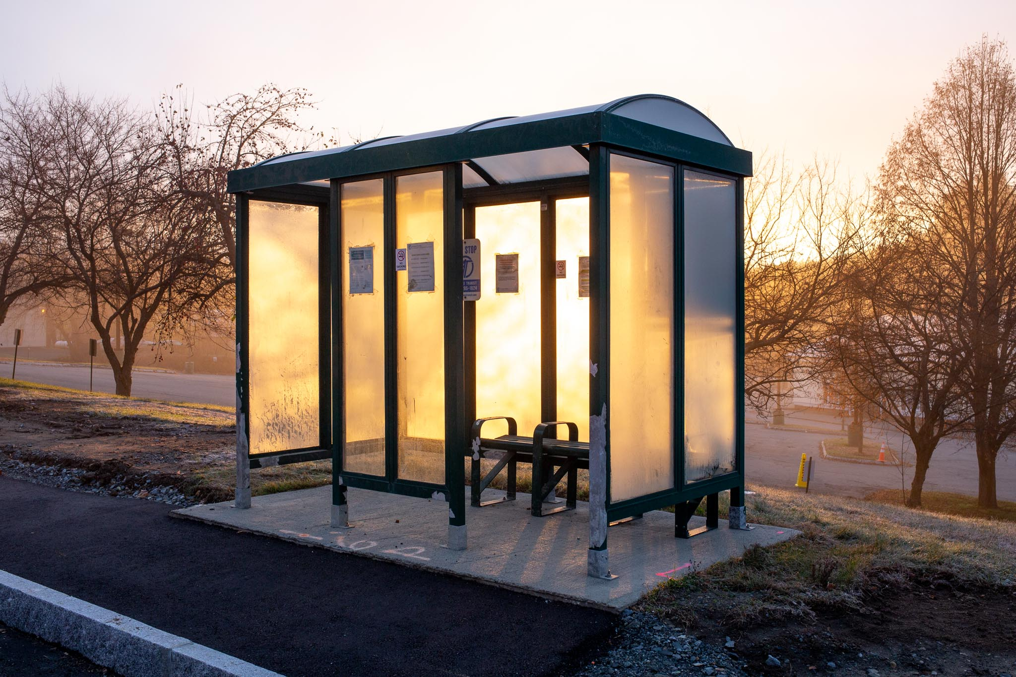 Sunrise Through Bus Stop Shelter