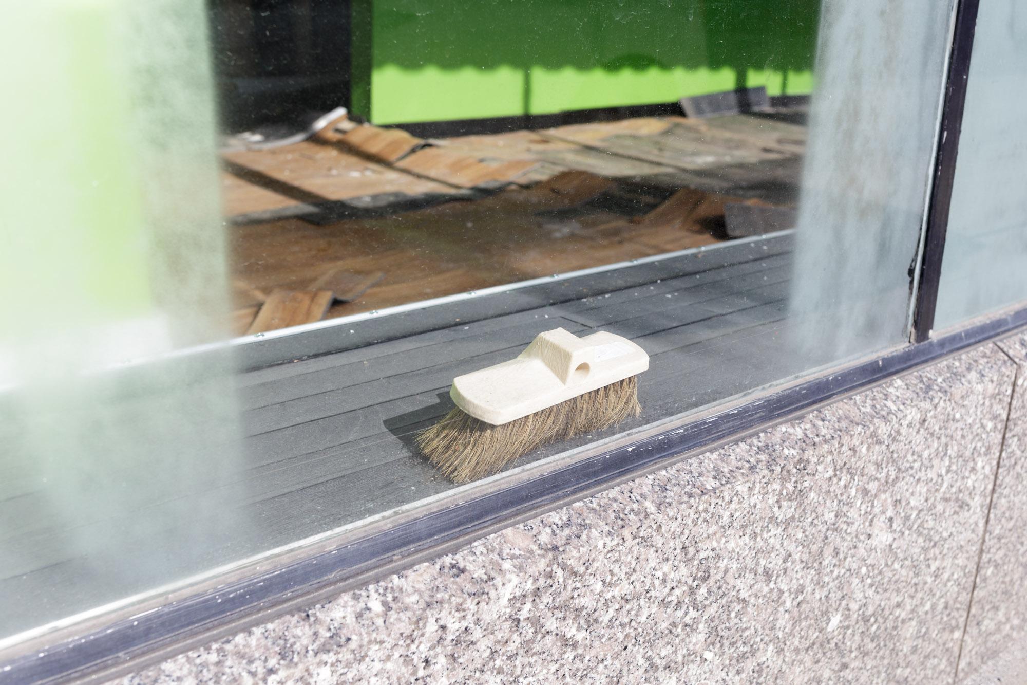 Broom Head in Window